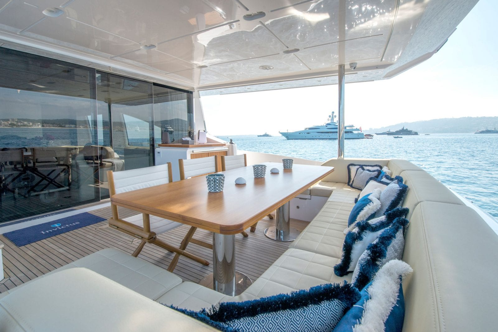 table setup with seating on back side of yacht