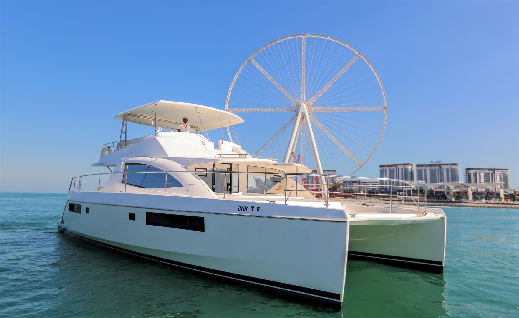 catamaran with ain wheel on background